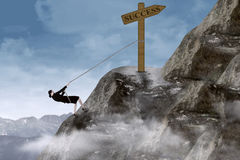 Businesswoman climbing mountain. Businesswoman climbing the mountain with success sign on top Royalty Free Stock Images