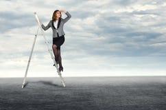 Businesswoman climbing the stairs Stock Photo