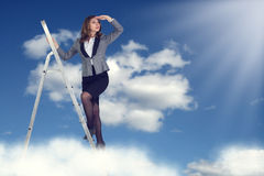 Businesswoman climbing the stairs. To the sky looking into the distance Royalty Free Stock Image