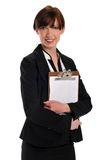 Businesswoman with clipboard. Businesswoman holding a clipboard isolated on a white background Stock Photos