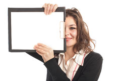 BusinessWoman with clipboard. In front of her face Royalty Free Stock Images