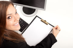 Businesswoman with clipboard Stock Image