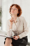 Businesswoman with clipboard. Stock Photography