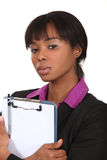 Businesswoman with clipboard. Royalty Free Stock Photos