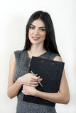 Businesswoman with clipboard. royalty free stock photography
