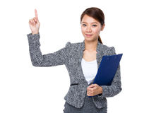 Businesswoman with clipboard and finger up Stock Image