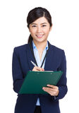 Businesswoman with clipboard Royalty Free Stock Image
