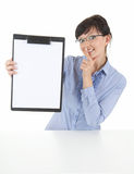 Businesswoman with clipboard keeping silent Stock Images