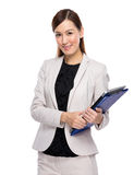 Businesswoman with clipboard and laptop Royalty Free Stock Photography