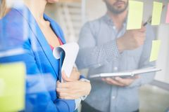 Working moment. Businesswoman with clipboard listening to colleague idea during discussion of reminders Stock Photos
