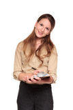 Businesswoman - clipboard notes. Isolated studio shot of a smiling Caucasian businesswoman taking notes on a clipboard Royalty Free Stock Images