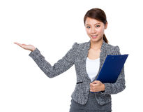 Businesswoman with clipboard and open hand palm Royalty Free Stock Photo
