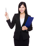 Businesswoman with clipboard and pen up Stock Images