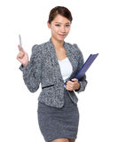 Businesswoman with clipboard and pen up Royalty Free Stock Image
