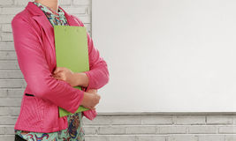 Businesswoman with clipboard standing beside blank whiteboard Royalty Free Stock Photography