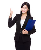 Businesswoman with clipboard and thumb up Royalty Free Stock Image