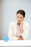 Businesswoman with clock Royalty Free Stock Photos