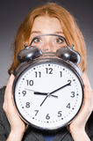 Businesswoman with clock being late Royalty Free Stock Photos