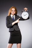 Businesswoman with clock being late Royalty Free Stock Image