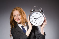 Businesswoman with clock being late Royalty Free Stock Images