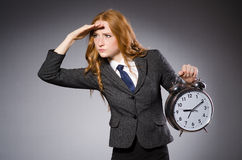 Businesswoman with clock being late Stock Image