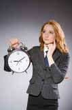 Businesswoman with clock being late Royalty Free Stock Photo