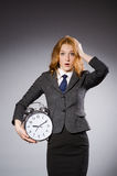Businesswoman with clock being late Stock Images