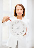 Businesswoman with clock Stock Images