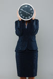 Businesswoman with a clock Royalty Free Stock Image