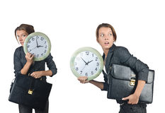 The businesswoman with clock isolated on white Stock Image