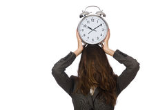 Businesswoman with clock missing Royalty Free Stock Photography