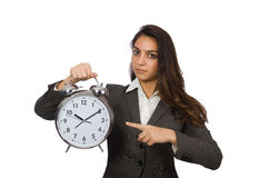 Businesswoman with clock missing her deadlines Royalty Free Stock Photography