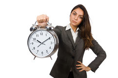 Businesswoman with clock missing her deadlines Stock Image