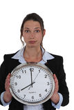 Businesswoman with a clock Stock Image