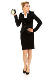 Businesswoman with clock - time concept Royalty Free Stock Image