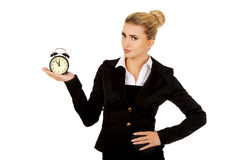 Businesswoman with clock - time concept Stock Photography