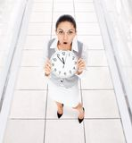 Businesswoman clock worried Royalty Free Stock Photography