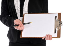 Businesswoman close up holding clipboard and pen Stock Photo