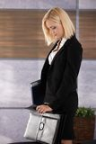 Businesswoman closing briefcase Stock Photo