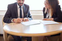 Businesswoman closing a deal with client Stock Photography