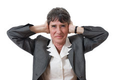 Businesswoman closing ears Stock Photos