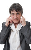 Businesswoman closing ears Stock Photography