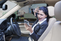 Businesswoman closing her face in car Stock Photos
