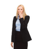 Businesswoman closing her mouth with hand Royalty Free Stock Photos