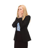 Businesswoman closing her mouth with hands Stock Image
