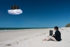 Businesswoman and cloud computing on beach Stock Photography
