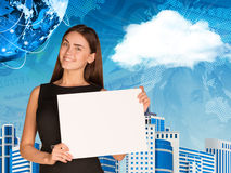 Businesswoman with cloud, Earth, skyscrapers and Stock Photography