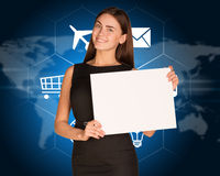 Businesswoman with cloud of icons and world map Royalty Free Stock Photos