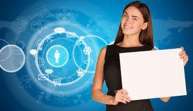 Businesswoman with cloud icons and world map Royalty Free Stock Images