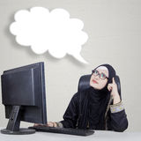 Businesswoman and cloud of idea. Young businesswoman looking at empty cloud speech while imagine an idea Stock Images